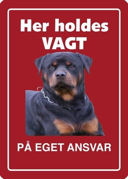 Her holdes vagt PÅ EGET ANSVAR. Hundeskilt