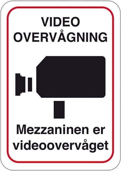 Mezzaninen er videoovervåget. Skilt