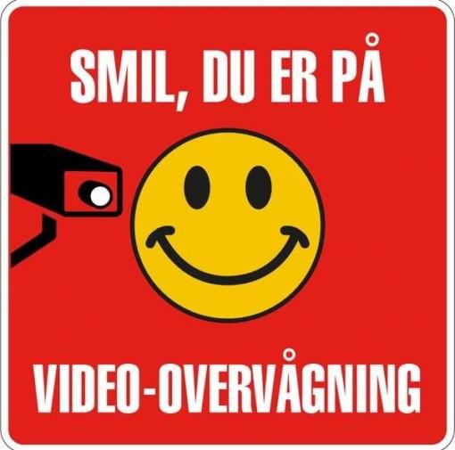 Smil du er på Video-overvågning Skilt (hvid på rød)